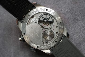 The in-house movement is crescent shaped and wound by a micro-rotor.