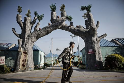 An employee walks through Red Beans Mansion, a holiday resort and amusement park converted from an abandoned coal mine near Gujiao, China.