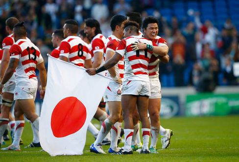 Japanese rugby players celebrate following their upset victory over powerhouse South Africa during the 2015 Rugby World Cup Pool B match in Brighton, United Kingdom on Sept. 19, 2015.