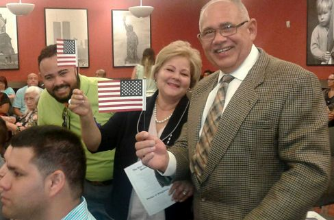 Delcy Vasquez, center, on day she took her citizenship oath.