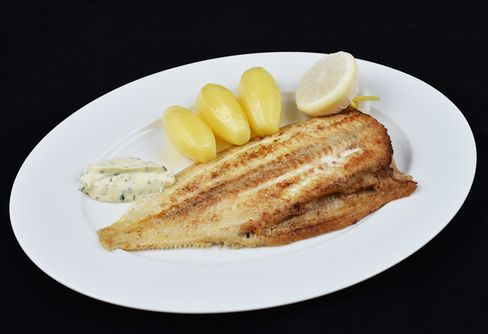 Grilled Dover sole was cooked perfectly and was enjoyable with added salt.