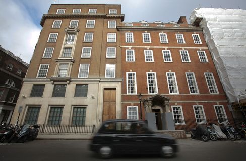A London Taxi Passes a Property in St James's Square