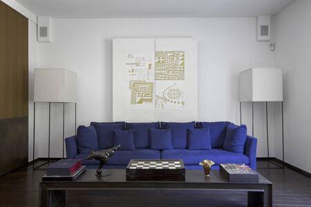 Silvera lamps flank an Italian sofa.