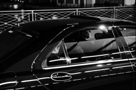 A chauffeur-driven limousine, carrying a bank client, in Geneva's banking district.
