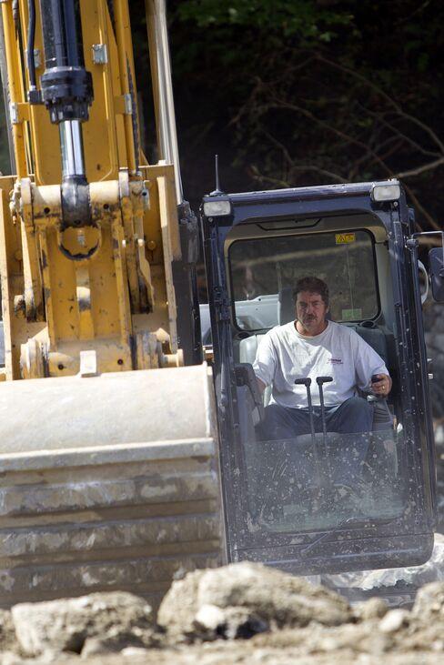Craig Mosher Operates an Excavator In Killington