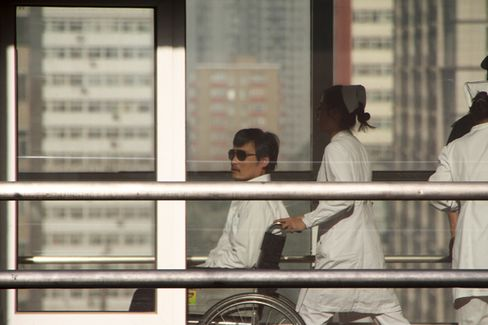 China's Blind Activist Exits Embassy, Fate Uncertain