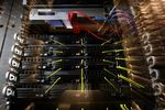 Working servers stand inside pod one of International Business Machines Corp.'s (IBM) Softlayer data center in Dallas, Texas, U.S.
