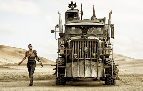 As one-armed Furiosa, Theron assuredly drives her own War Rig.