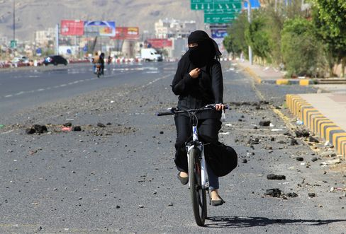 A Woman Rides A Bicycle In Sana'a As Yemen Faces Fuel Shortage