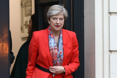 Theresa May leaves the Conservative Party campaign headquarters on June 9.