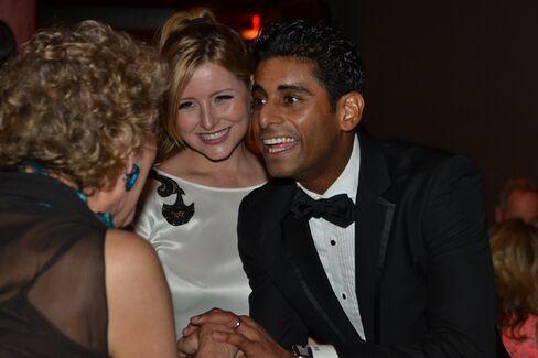 Amar Ramasar, far right, and his wife, Elysia greet a patron.