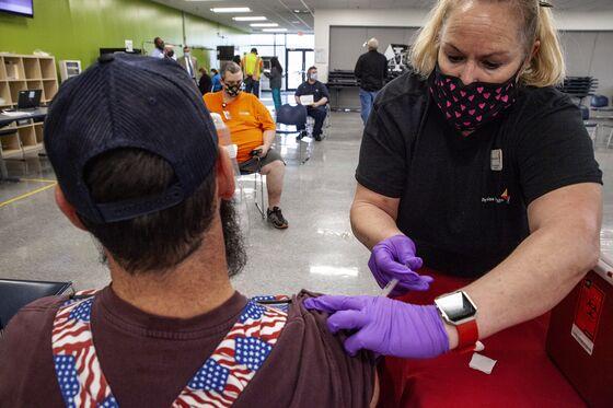 U.S. Factory Floor Is Next Battle in Biden's Vaccination Drive