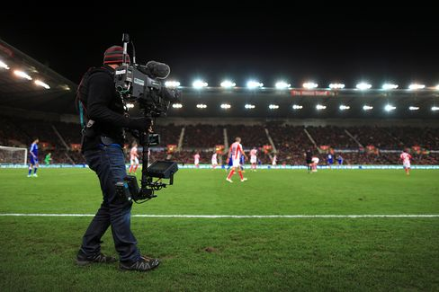 A Television Cameraman Works at a Premier League Match