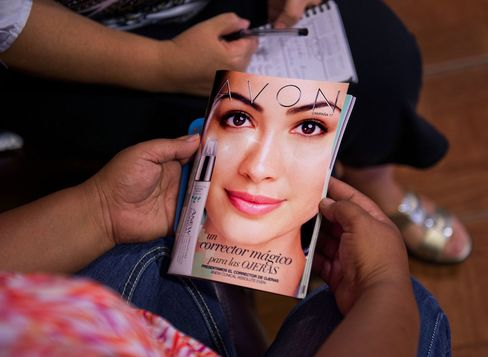 A customer views an Avon Products Inc. product catalog in McAllen, Texas, on Aug. 28, 2014.