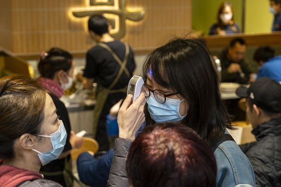 Disney Bans Hugs and China Cleans Cash in Virus-Sparked Hygiene