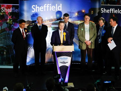 Nick Clegg, leader of the Liberal Democrats, stands at the podium and speaks from the count at the English Institute of Sport after retaining his constituency seat for Sheffield Hallam in Sheffield, U.K.