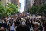 Protesters march through midtown as part of a demonstration Tuesday, June 2, 2020, in New York。