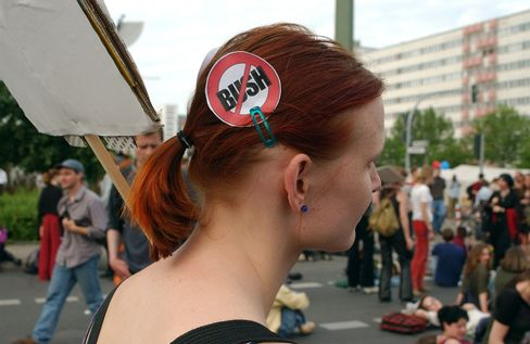 A woman protests the visit of then-U.S. President George W. Bush in Berlin in 2002.