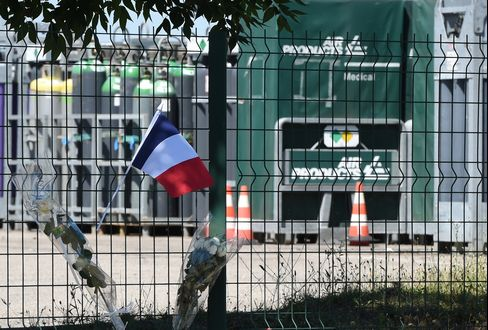 A French flag outside the gas plant in Saint-Quentin-Fallavier