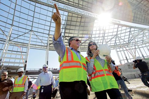 Loria and his wife, Julie, touring the stadium in 2011