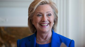 Democratic Presidential candidate Hillary Clinton chats with supporters during a campaign stop at the home of Chuck and Linda Smoley on June 13, 2015 in Sioux City, Iowa.