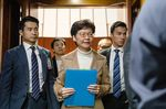 Carrie Lam leaves after a question-and-answer session on Jan. 16.