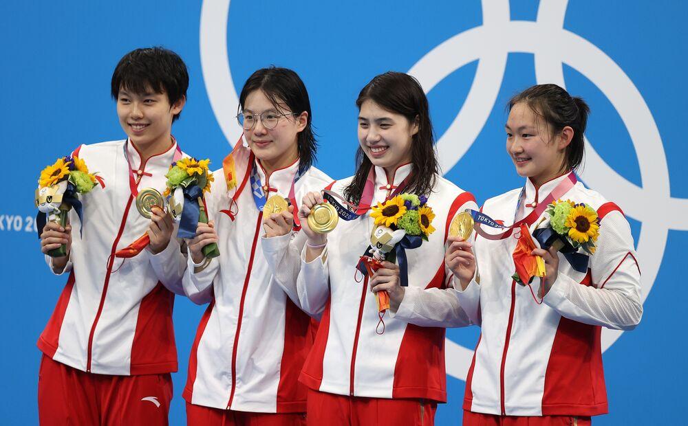 Olympics Latest: American Swimmer Schmitt Wins 10th Medal - Bloomberg