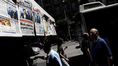 Newspaper front pages reporting the latest developments on the Greek debt negotiations in Brussels outside a newspaper kiosk in Thessaloniki, Greece, on June 25, 2015.