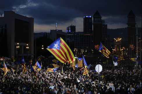Supporters of Catalan independence attend a rally ahead of the vote in Barcelona, on Sept. 25.