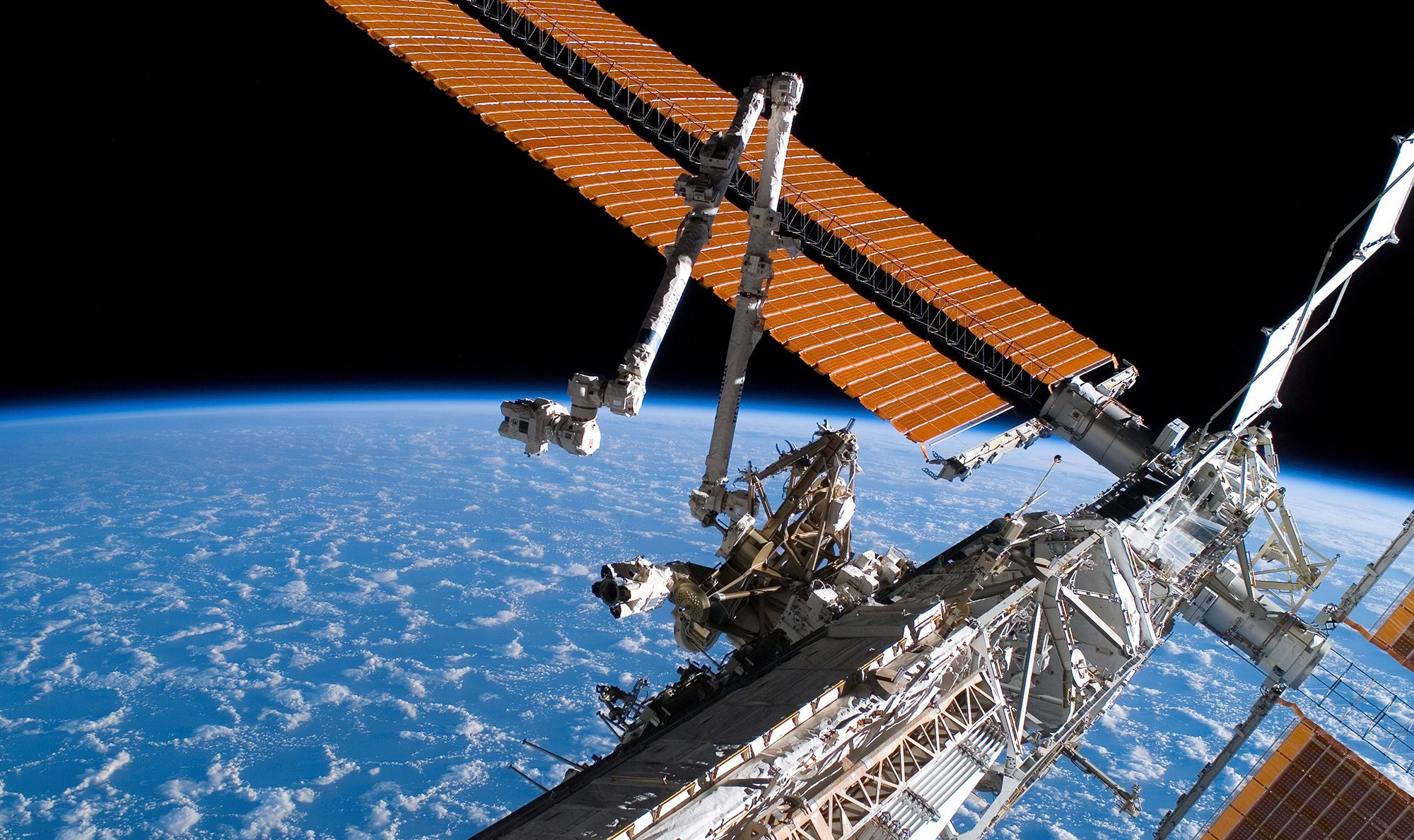 In this photo provided by NASA, the Canadarm2 and solar array panel wings on the International Space Station are extended during a 2007 mission.  -  1x 1 - Iconic Canadian Space Firm Targets $400 Million in IPO Return