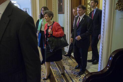 Iowa'sJoni Ernstleads a pack of fellow Republican senators-electout of the Senate chamber during a tour at the U.S.Capitolin WashingtononNov. 12, 2014, including, fromleft, James LankfordofOklahoma, Mike RoundsofSouth Dakota, and Tom CottonofArkansas.