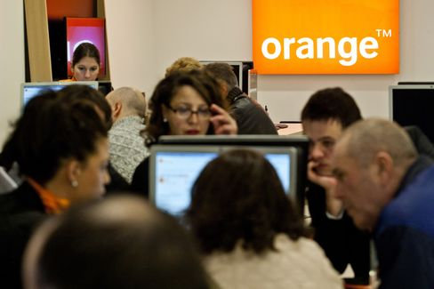 Shoppers Browse Products Inside the Orange SA Store in Toulouse