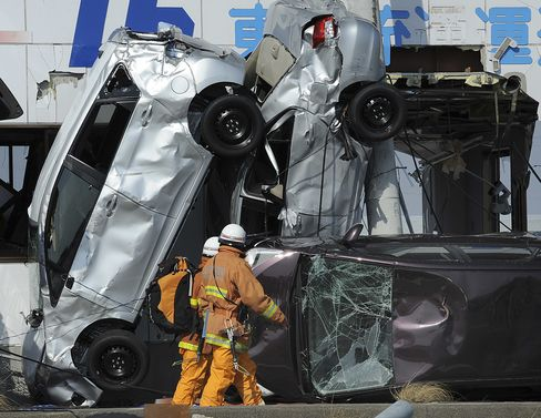 Rescuers Pass Upturned Cars