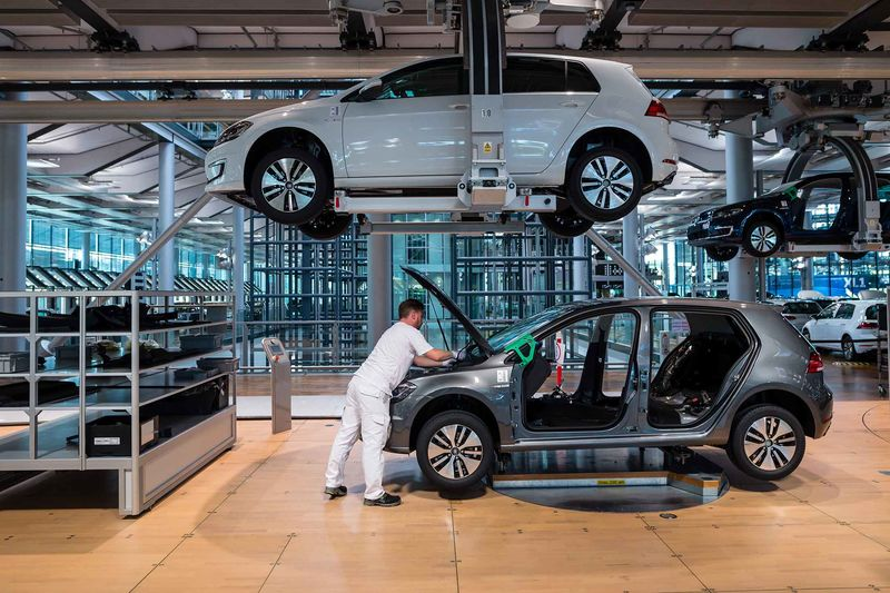 Volkswagen workers build a Golf electric car at a factory in Dresden.