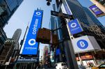 Monitors display Coinbase signage during the company's initial public offering (IPO) at the Nasdaq MarketSite in New York, U.S., on Wednesday, April 14, 2021. Coinbase Global Inc., the largest U.S. cryptocurrency exchange, is set to debut on Wednesday through a direct listing, an alternative to a traditional initial public offering that has only been deployed a handful of times.