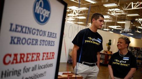 Employees wait to greet job seekers during a Kroger Co. Hiring Fair at one of the company's grocery stores in Lexington, Kentucky, U.S., on Wednesday, Oct. 8, 2014.