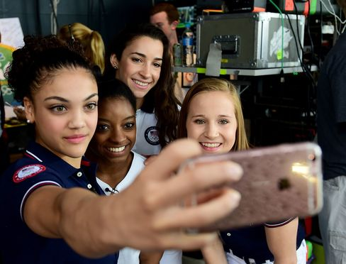 Laurie Hernandez takes a photo with Simone Biles, Aly Raisman and Madison Kocian on the Today Show set at Copacabana Beach in Rio de Janeiro, on August 18, 2016.