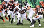 The Jacksonville Jaguars runwith the ball in Cincinnati, Ohio.