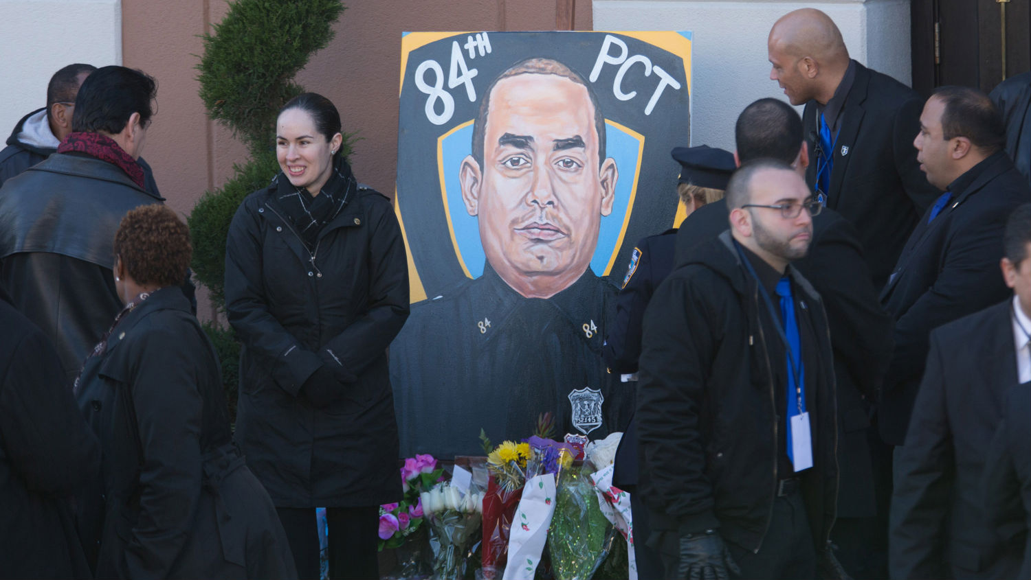 A portrait of NYPD officer Rafael Ramos is placed outside his funeral.