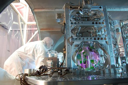 A technician works on one of LIGO's optics.