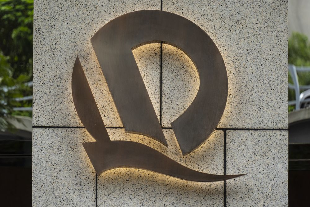 The China Evergrande Group logo is displayed in front of the China Evergrande Centre in Hong Kong.