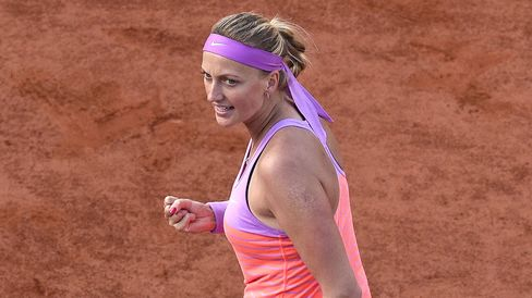 Czech Republic's Petra Kvitova celebrates after winning a point against Switzerland's Timea Bacsinszky during the women's fourth round match of the Roland Garros 2015 French Tennis Open in Paris on June 1, 2015.