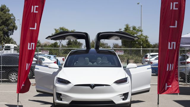 Tesla involved in fatal crash sped up before hitting road barrier