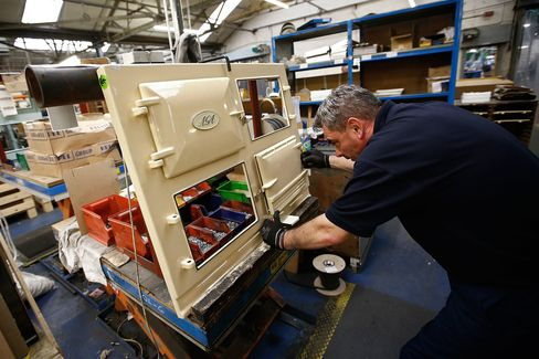 An employee fits a door to an AGA 3-Oven Classic range cooker at the company's plant in Telford, U.K.