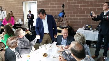 Senator ted cruz of texas greets activists saturday evening prior to speaking at the iowa faith & freedom coalition dinner in des moines, iowa.
