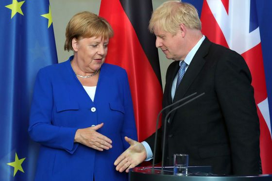 U.K. Sees Room for Maneuver on Brexit After Merkel, Macron Talks