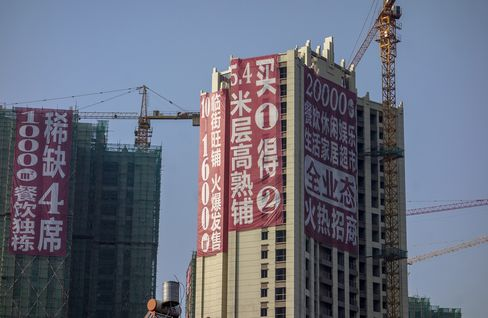 Huge promotion advertisement hangs on a real estate project