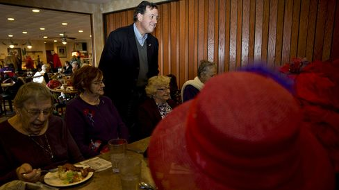 Rick Santorum speaks with members of the Red Hat Society at a Pizza Ranch restaurant in Mason City, Iowa, on Jan. 27, 2016.
