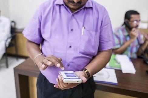 A municipal employee in Navi Mumbai tracks a complaint of debris-dumping, using WhatsApp on his smartphone.