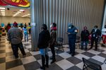 Voters stand in line to cast ballots at a polling location in Atlanta, on Jan 5.